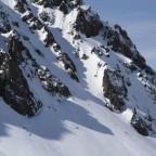 Female snowboarder bottom right speck!