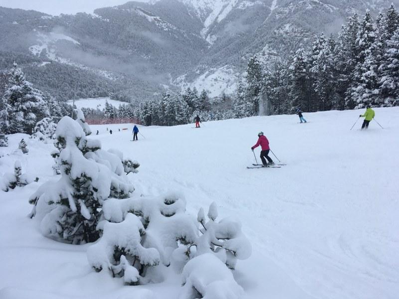 Skiers riding down El Bec