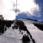Heading up the chairlift La Botella with some clouds in the sky
