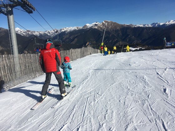 Children having a lesson with the ski intructor
