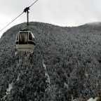 The gondola going up on a white day
