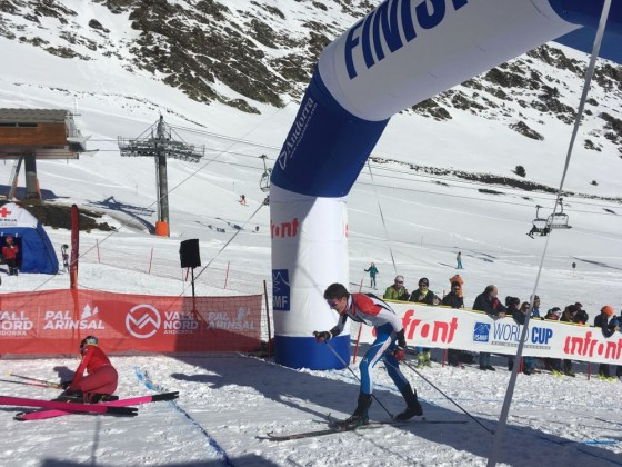 Skier crossing the finish line in Arinsal