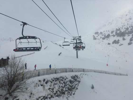 Heading up Les Fonts chairlift under the snowfall