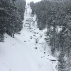 The river is totally frozen under the chairlift Josep Serra