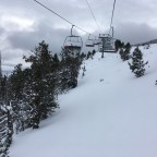 Heading up the chairlift La Botella with an untouched powder view