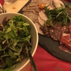 Salad and cold meats for the first course of the fondue meal in Xalet Igloo