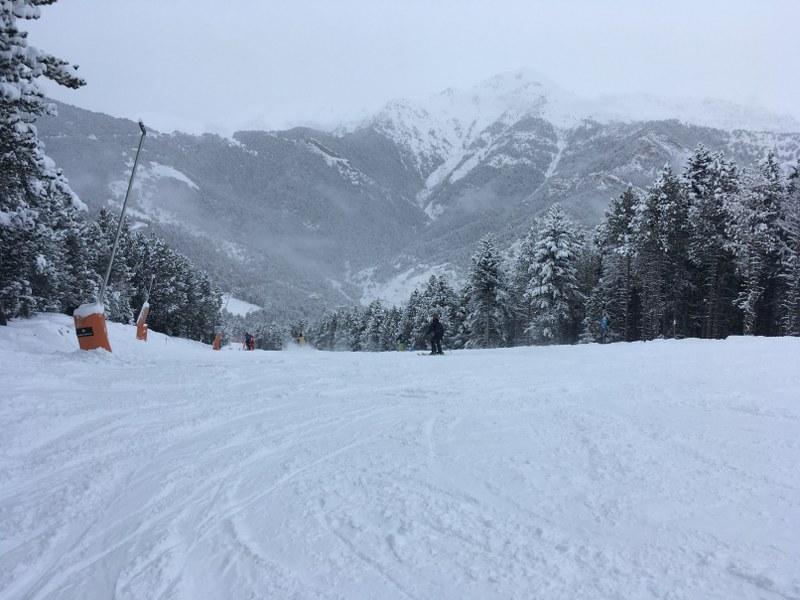 Skiing down blue slope El Bec