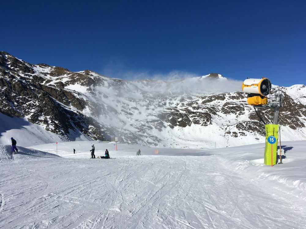 The snow cannons are working hard to ensure the snow in the sunniest days