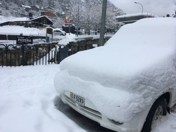 The cars were covered in snow