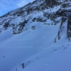 Some skiers making lines on the off-piste of Arcalís