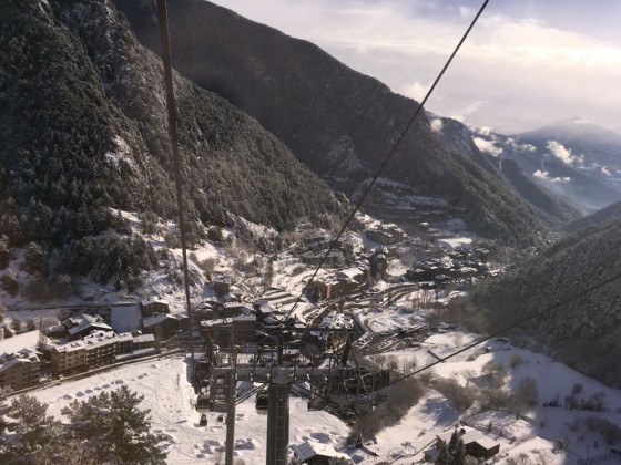 Heading up the gondola of Arinsal with stunnng views of the village covered in white