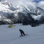 Riding the powder snow next to the FWT helicopter