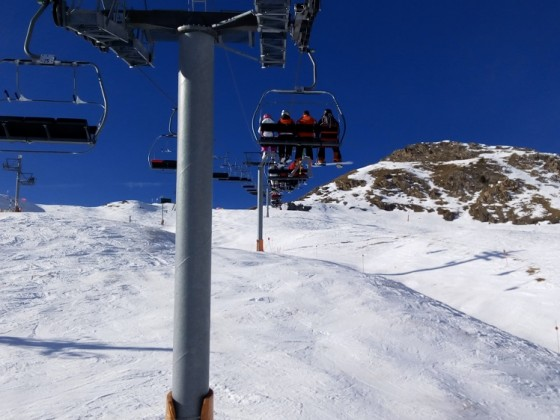 Heading up on the chairlift Port Negre