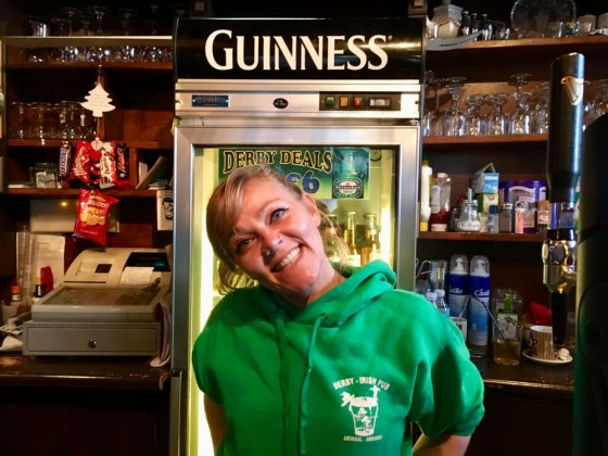 Annie behind the bar of The Derby Irish Bar