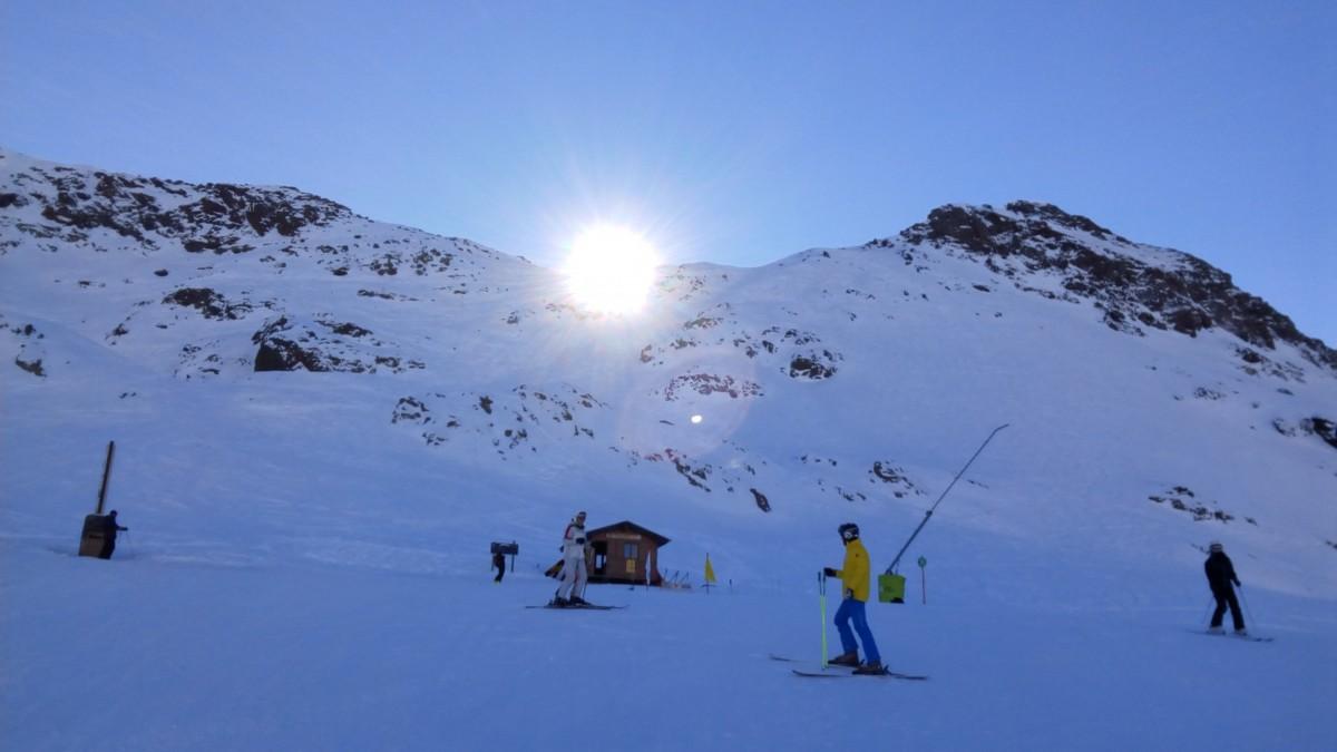 The sun rising over the peaks of Arcalís