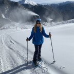 Esther walking up the slopes with snow shoes