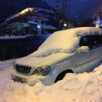 Some cars are stuck under the snow