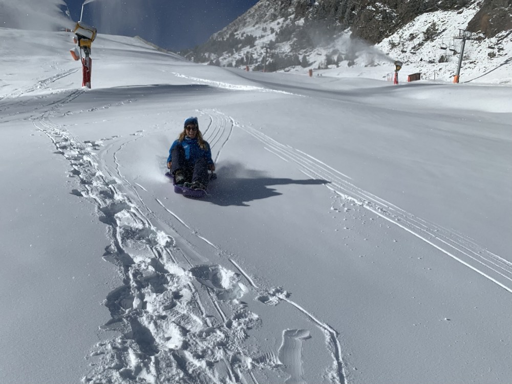 Esther sledging on the nursery slopes
