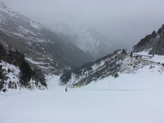Skiing down La Canaleta red slope