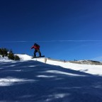 Instructor jumping on the off-piste of Pal
