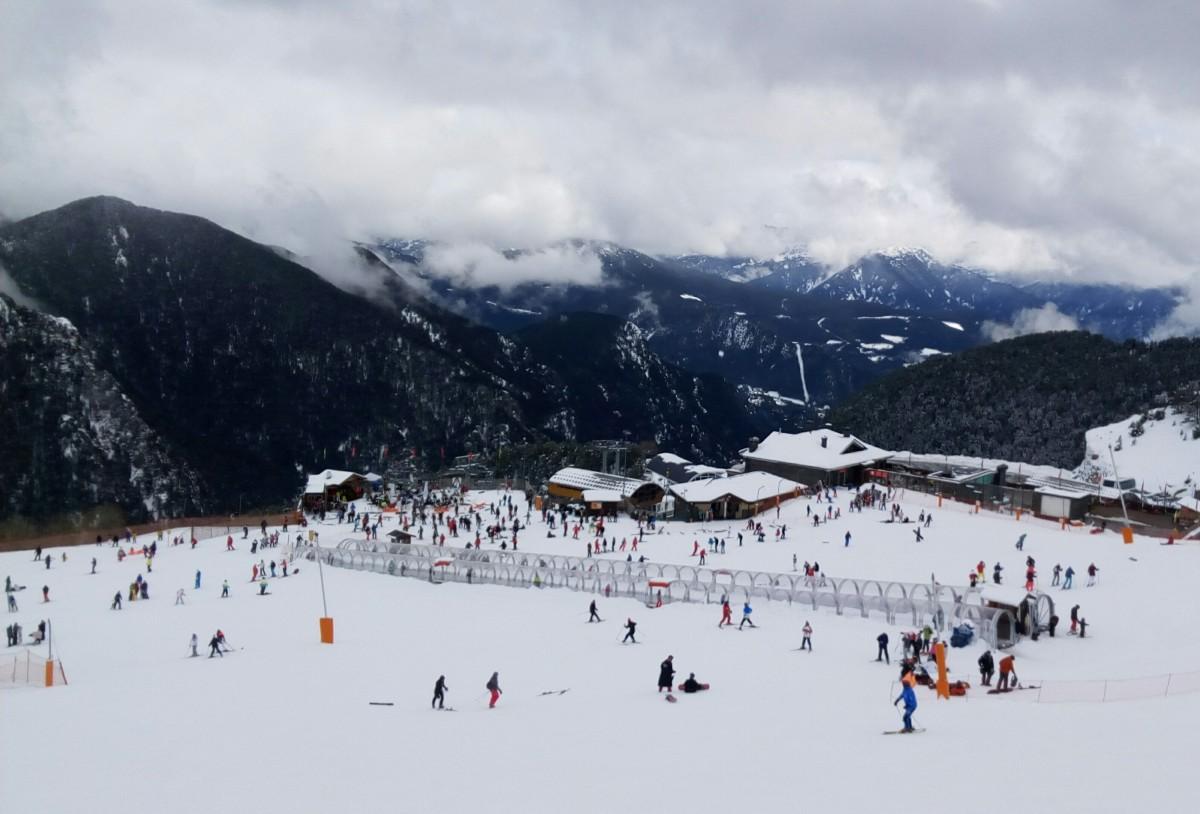 The base of Arinsal with some clouds on the horizon